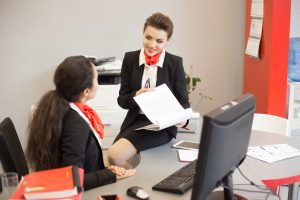 Young Businesswoman in Agency