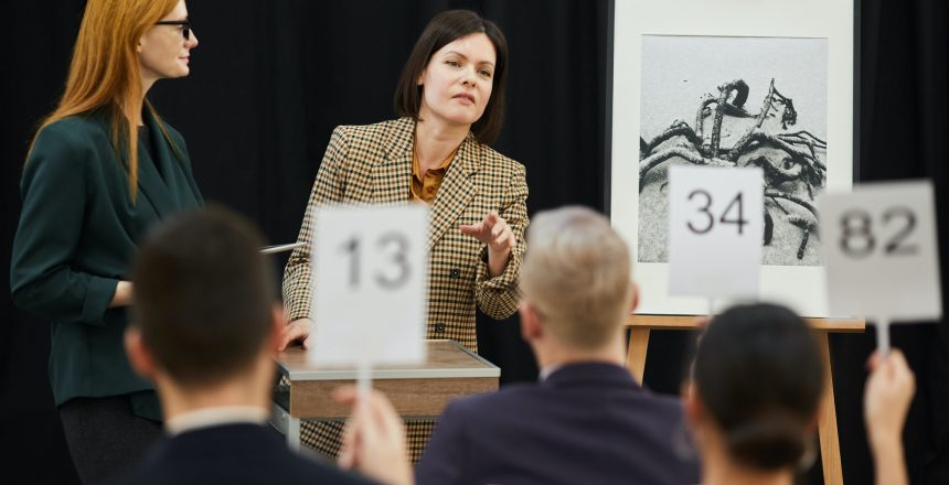 Woman choosing the candidate at auction